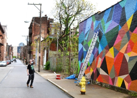 Matt W. Moore, noted muralist working on Clay Street in Over-the-Rhine, Cincinnati
